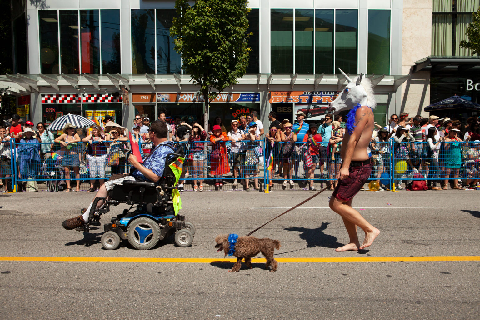 Unicorn walking dog, Vancouver Pride, Canada, 2014